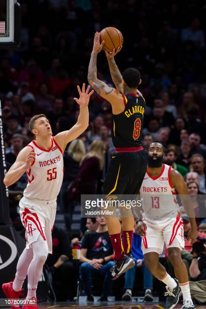 Isaiah Hartenstein and James Harden of the Houston Rockets attempt to block Jordan Clarkson of the Cleveland Cavaliers during the first half at...