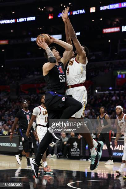 Isaiah Hartenstein of the LA Clippers takes a shot against Evan Mobley of the Cleveland Cavaliers in the third quarter at Staples Center on October...