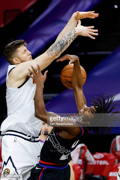 Isaiah Hartenstein of the Denver Nuggets blocks Tyrese Maxey of the Philadelphia 76ers during the first quarter at Wells Fargo Center on January 09,...