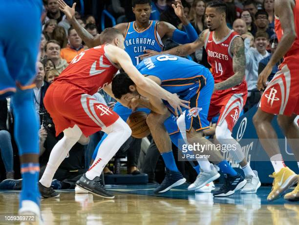 Isaiah Hartenstein of the Houston Rockets and Alex Abrines of the Oklahoma City Thunder battle for the ball during the first half of a NBA game at...