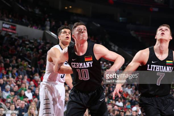 Isaiah Hartenstein of the World Select Team boxes out against Michael Porter Jr #9 of the USA Junior Select Team during the game on April 7 2017 at...