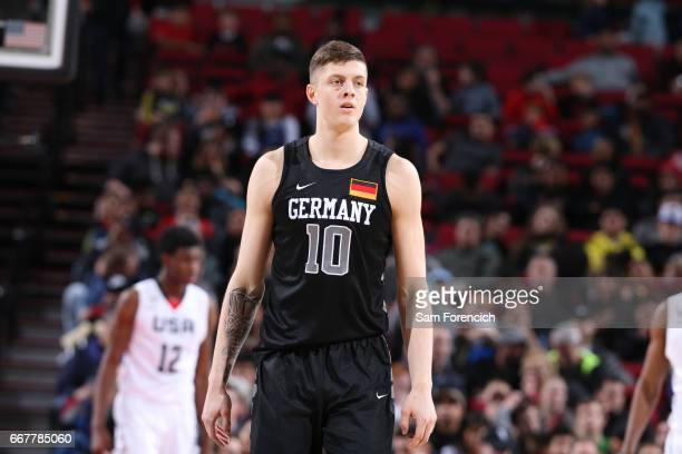 Isaiah Hartenstein of the World Select Team looks on against the USA Junior Select Team during the game on April 7 2017 at the MODA Center Arena in...