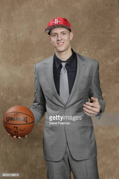 Isaiah Hartenstein poses for a portrait after being selected forty third overall by the Houston Rockets during the 2017 NBA Draft on June 22 2017 at...