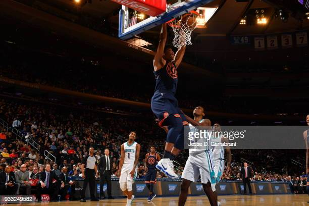 Isaiah Hicks of the New York Knicks dunks the ball against the Charlotte Hornets at Madison Square Garden on March 17 2018 in New YorkNew York NOTE...