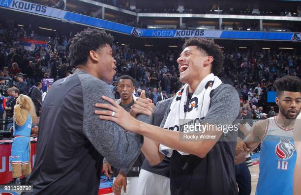 Isaiah Hicks of the New York Knicks greets Justin Jackson of the Sacramento Kings after the game on March 4 2018 at Golden 1 Center in Sacramento...