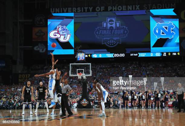 Isaiah Hicks of the North Carolina Tar Heels and Johnathan Williams of the Gonzaga Bulldogs go up for the opening tip during the 2017 NCAA Men's...