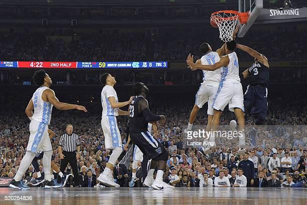 Isaiah Hicks of the North Carolina Tar Heels blocks a shot by Josh Hart of the Villanova Wildcats during the 2016 NCAA Men's Final Four Championship...