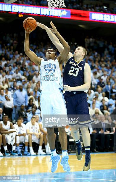 Isaiah Hicks of the North Carolina Tar Heels drives to the basket against Martinas Geben of the Notre Dame Fighting Irish during their game at Dean...