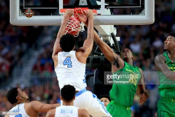 Isaiah Hicks of the North Carolina Tar Heels dunks against Kavell BigbyWilliams of the Oregon Ducks in the first half during the 2017 NCAA Men's...