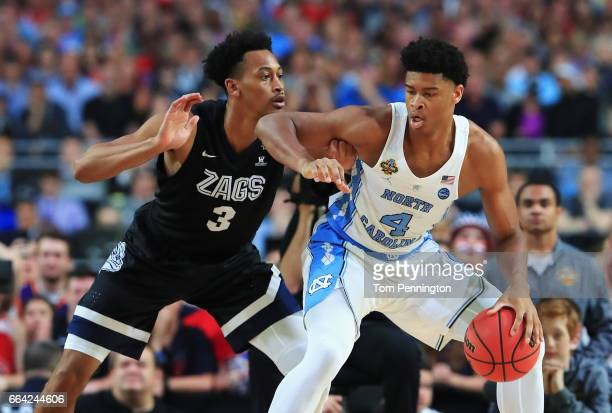 Isaiah Hicks of the North Carolina Tar Heels handles the ball against Johnathan Williams of the Gonzaga Bulldogs in the first half during the 2017...