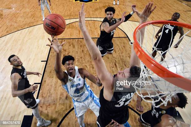 Isaiah Hicks of the North Carolina Tar Heels shooots against Zach Collins of the Gonzaga Bulldogs in the first half during the 2017 NCAA Men's Final...