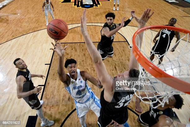 Isaiah Hicks of the North Carolina Tar Heels shoots a jumpshot over Zach Collins of the Gonzaga Bulldogs during the 2017 NCAA Men's Final Four...
