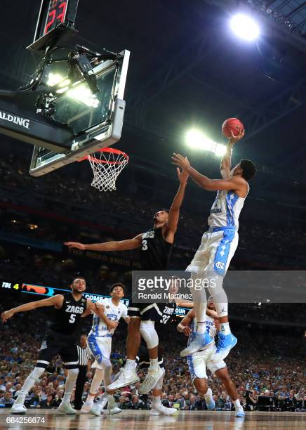 Isaiah Hicks of the North Carolina Tar Heels shoots against Johnathan Williams of the Gonzaga Bulldogs in the first half during the 2017 NCAA Men's...