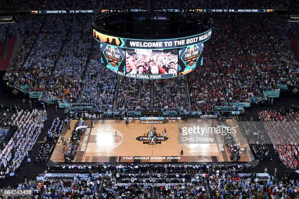 Isaiah Hicks of the North Carolina Tar Heels tips offwith Johnathan Williams of the Gonzaga Bulldogs during the 2017 NCAA Men's Final Four National...