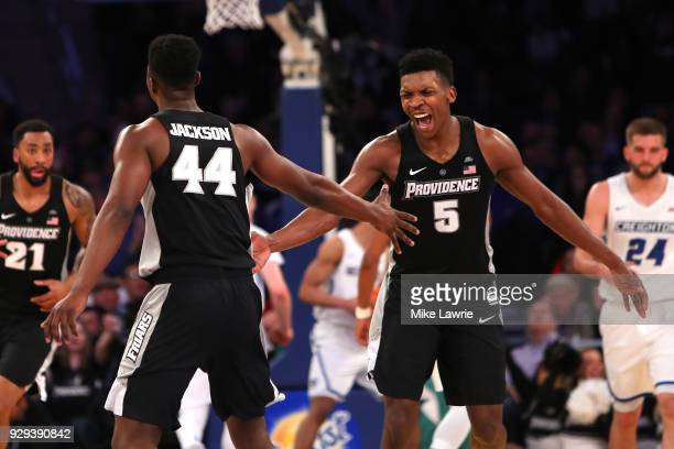 Isaiah Jackson and Rodney Bullock of the Providence Friars react after a play in the second half against the Creighton Bluejays during the Big East...