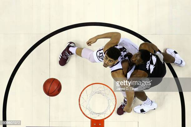 Isaiah Jackson of the Providence Friars and Tyler Davis of the Texas AM Aggies look to rebound during the first round of the 2018 NCAA Men's...