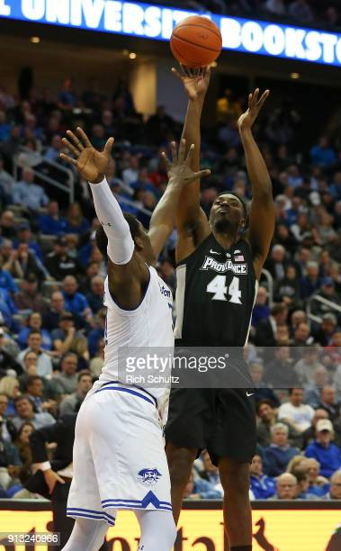 Isaiah Jackson of the Providence Friars attempts a shot as Angel Delgado of the Seton Hall Pirates defends during the second half of a game at...