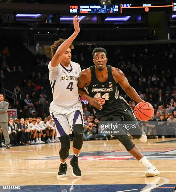 Isaiah Jackson of the Providence Friars dribbles against Matisse Thybulle of the Washington Huskies during the 2K Classic at Madison Square Garden on...