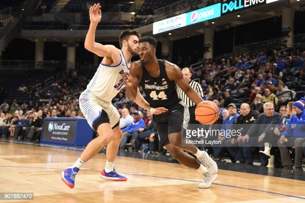 Isaiah Jackson of the Providence Friars dribbles around Max Strus of the DePaul Blue Demons during a college basketball game at Wintrust Arena on...