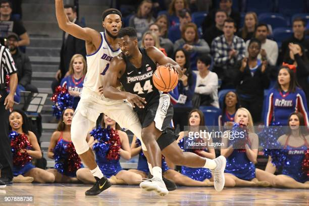 Isaiah Jackson of the Providence Friars dribbles around Tre'Darius McCallum of the DePaul Blue Demons during a college basketball game at Wintrust...