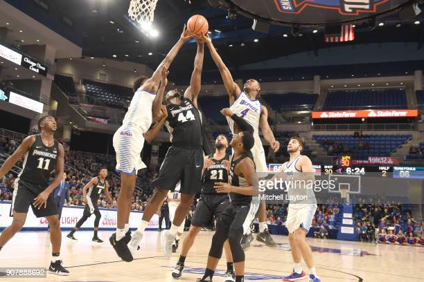 Isaiah Jackson of the Providence Friars fights for a rebound with Eli Cain and Brandon Cyrus of the DePaul Blue Demons during a college basketball...
