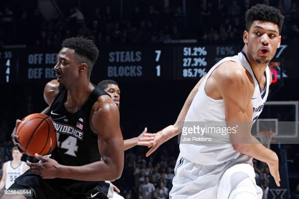 Isaiah Jackson of the Providence Friars pulls a rebound away from Kaiser Gates of the Xavier Musketeers in the second half of a game at Cintas Center...