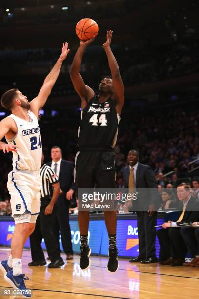 Isaiah Jackson of the Providence Friars shoots against Mitch Ballock of the Creighton Bluejays in the first half during the Big East basketball...