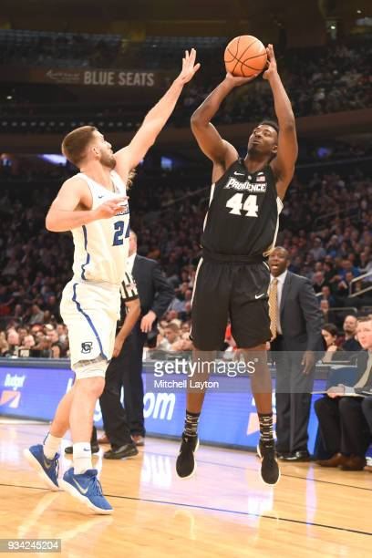 Isaiah Jackson of the Providence Friars takes a jump shot against Mitch Ballock of the Creighton Bluejays during the quarterfinal round the Big East...