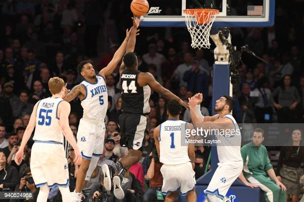 Isaiah Jackson of the Providence Friars takes a shot over Trevon Bluiett of the Xavier Musketeers during the semifinals of the 2018 Big East Mens...