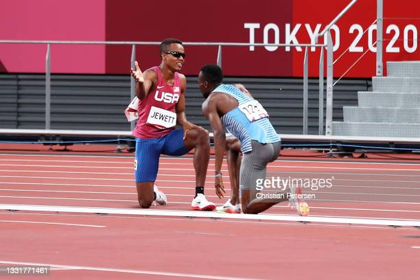 Isaiah Jewett of Team United States and Nijel Amos of Team Botswana react after falling in the Men's 800m Semi-Final on day nine of the Tokyo 2020...