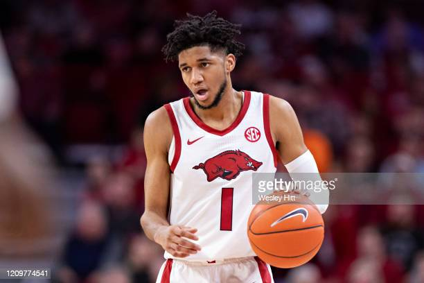 Isaiah Joe of the Arkansas Razorbacks runs the offense during a game against the Tennessee Volunteers at Bud Walton Arena on February 26, 2020 in...