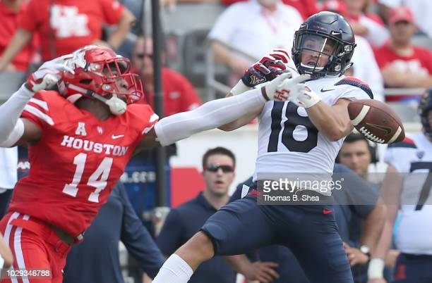 Isaiah Johnson of the Houston Cougars breaks up a pass intended for Cedric Peterson of the Arizona Wildcats in the first quarter at TDECU Stadium on...