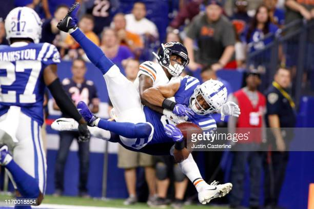 Isaiah Johnson of the Indianapolis Colts intercepts the ball during the preseason game against the Chicago Bears at Lucas Oil Stadium on August 24...