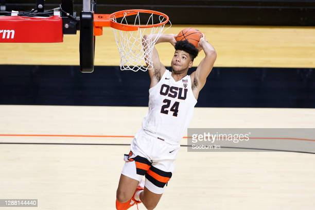 Isaiah Johnson of the Oregon State Beavers goes up for the dunk but is unable to finish against the the Northwest Eagles at Gill Coliseum on November...