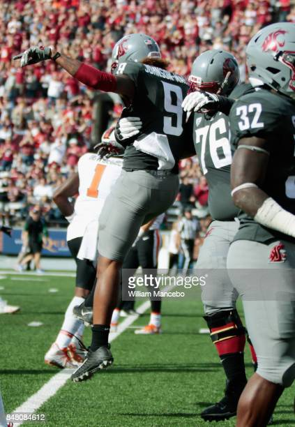 Isaiah JohnsonMack of the Washington State Cougars celebrates a touchdown with teammate Cody O'Connell against the Oregon State Beavers in the first...