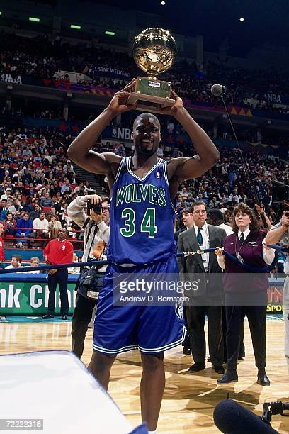 Isaiah JR Rider of the Minnesota Timberwolves holds the trophy after winning the 1994 Slam Dunk Contest on February 12 1994 at the Target Center in...