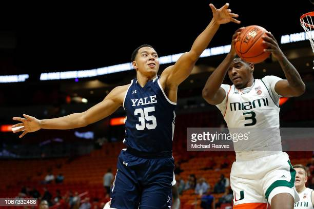 Isaiah Kelly of the Yale Bulldogs fights for a rebound with Anthony Lawrence II of the Miami Hurricanes during the HoopHall Miami Invitational at...