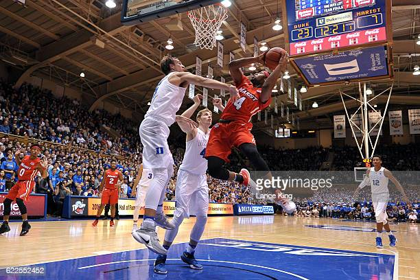 Isaiah Lamb of the Marist Red Foxes goes to the basket against Jack White and Luke Kennard of the Duke Blue Devils at Cameron Indoor Stadium on...