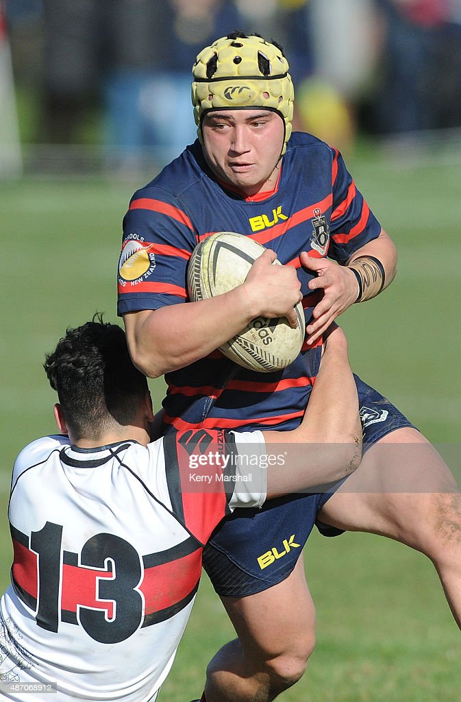 Isaiah Leach of Rotorua Boy's High School slips the tackle of Peter Umaga-Jensen of Scots College during the National 1st XV Championship Final match between Rotorua Boys' High School vs Scots College on September 6, 2015 in Rotorua, New Zealand.