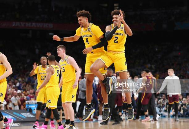 Isaiah Livers and Jordan Poole of the Michigan Wolverines celebrate in the second half against the Loyola Ramblers during the 2018 NCAA Men's Final...
