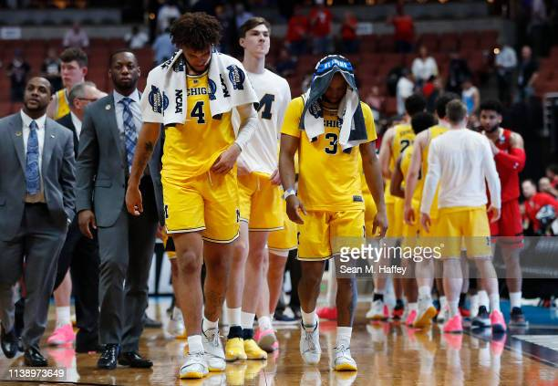 Isaiah Livers and Zavier Simpson of the Michigan Wolverines show their dejection after their loss to the Texas Tech Red Raiders during the 2019 NCAA...