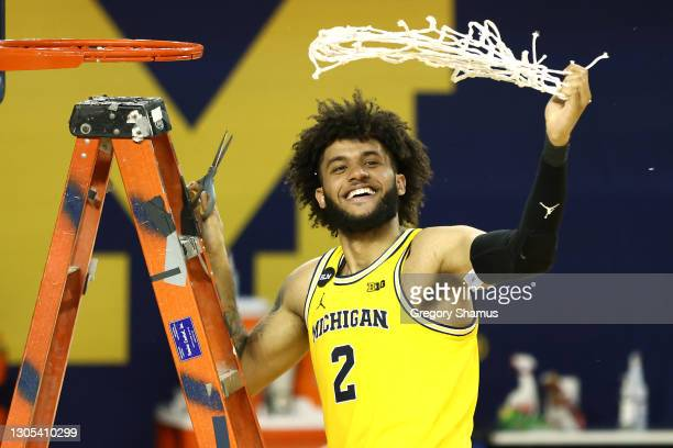 Isaiah Livers of the Michigan Wolverines celebrates his teams Big 10 championship after defeating the Michigan State Spartans 69-50 at Crisler Arena...