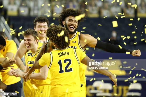 Isaiah Livers of the Michigan Wolverines celebrates his teams Big Ten championship with Mike Smith after defeating the Michigan State Spartans 69-50...