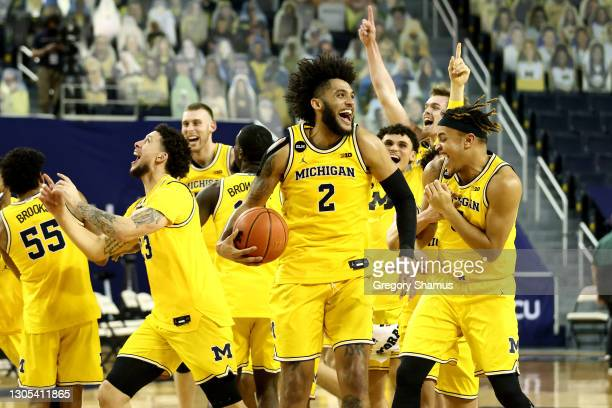 Isaiah Livers of the Michigan Wolverines celebrates his teams Big Ten championship after defeating the Michigan State Spartans 69-50 at Crisler Arena...