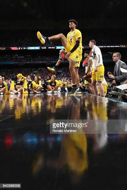 Isaiah Livers of the Michigan Wolverines celebrates with teammates in the second game against the Loyola Ramblers during the 2018 NCAA Men's Final...