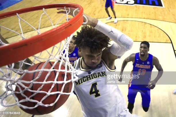 Isaiah Livers of the Michigan Wolverines dunks the ball against the Florida Gators during the second half in the second round game of the 2019 NCAA...