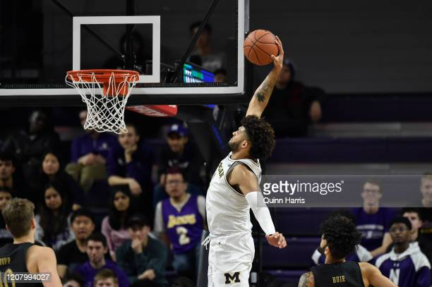 Isaiah Livers of the Michigan Wolverines dunks the basketball in the second half against the Northwestern Wildcats at Welsh-Ryan Arena on February...