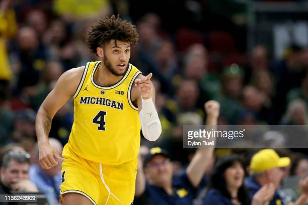 Isaiah Livers of the Michigan Wolverines reacts in the second half against the Minnesota Golden Gophers during the semifinals of the Big Ten...
