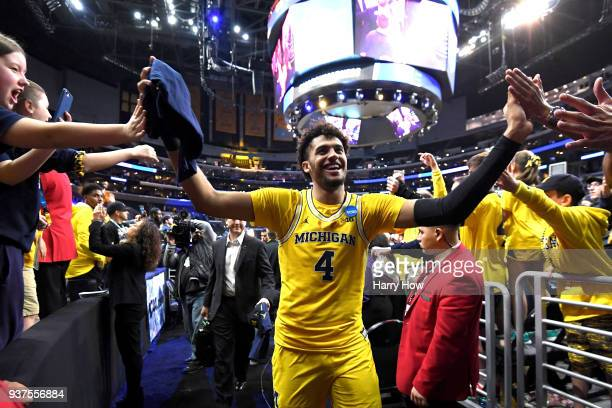 Isaiah Livers of the Michigan Wolverines walks off the court after defeating the Florida State Seminoles in the 2018 NCAA Men's Basketball Tournament...