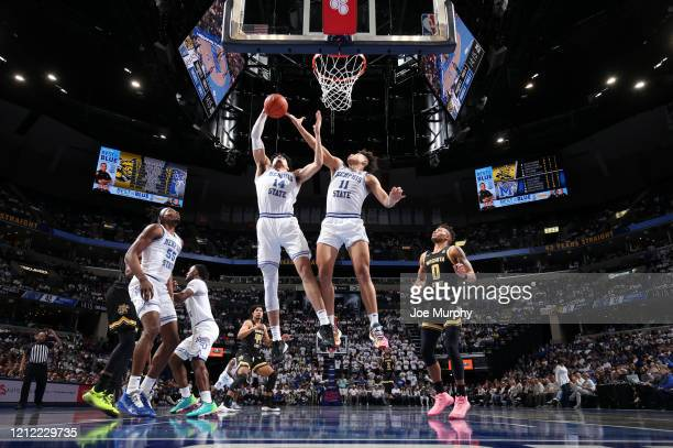 Isaiah Maurice and Lester Quinones of the Memphis Tigers jump for a rebound against the Wichita State Shockers during a game on March 5 2020 at...